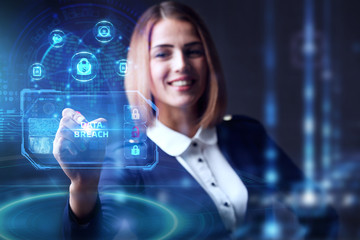 Business, technology, internet and networking concept. Young businessman working  in the office, select the icon Data breach  on the virtual display.