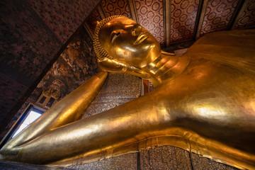 Poster Bangkok famous golden reclining buddha statue at wat pho bangkok thailand