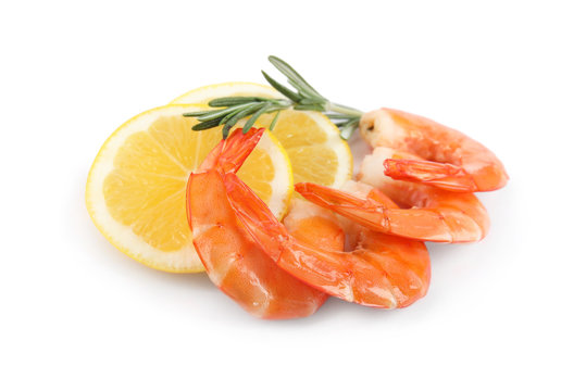 Delicious cooked shrimps, lemon and rosemary isolated on white