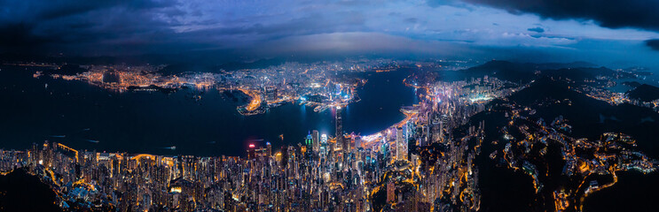 Fototapete - Amazing night aerial view of cityscape of Victoria Harbour, center of Hong Kong
