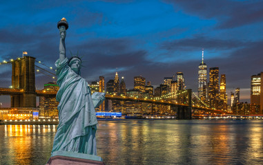 Wall Mural - The Statue of Liberty over the Scene of New york Cityscape with Brooklyn Bridge beside the east river at the twilight time,Architecture and building with tourist concept, United state of America, USA