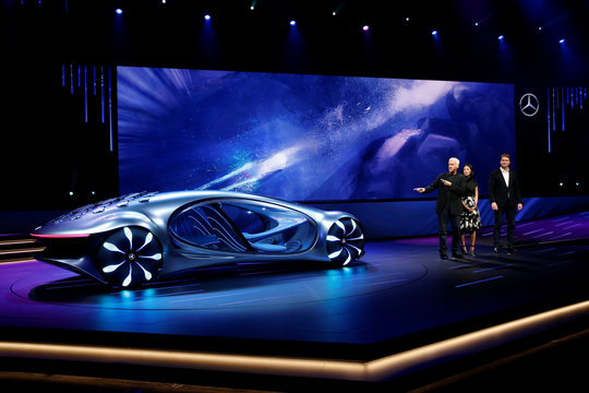 Director James Cameron, moderator Chi-Lan Lieu and Ola Kallenius, chairman of the board of Daimler AG and Mercedes-Benz AG, stand by the Mercedes-Benz Vision AVTR concept car during the 2020 CES in Las Vegas