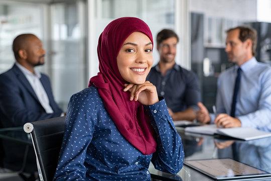 Islamic businesswoman wearing hijab in meeting