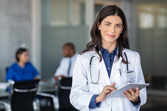 Doctor holding digital tablet at meeting room