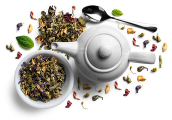 Green tea with natural flavors and a teapot. Top view on white background Wall mural