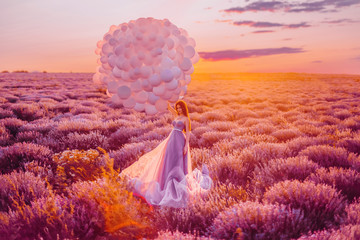 Fototapeten Koralle Beautiful female with balloons in lavender