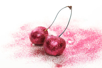 Cherry berries covered with a colorful glitters