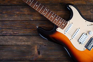 Close-up on electric guitar on vintage old wooden background Fotomurales