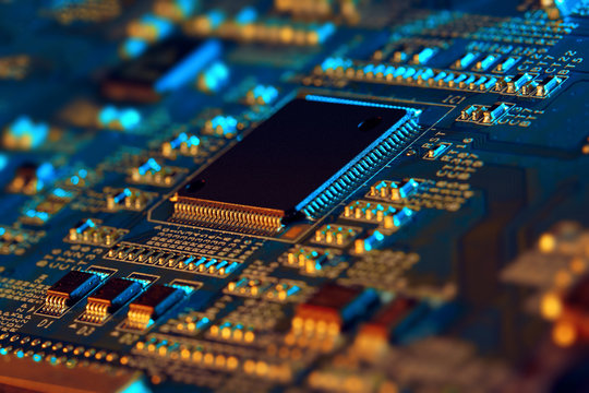 Electronic circuit board with electronic components such as chips close up. The concept of the electronic computer hardware technology.