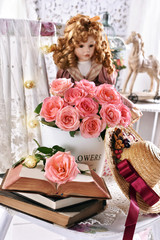 vintage style picture with bunch of pink roses books and a doll