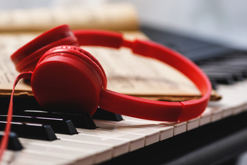 Red headphones over synthesizer keyboard