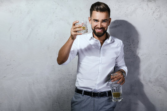 Handsome bearded man with a glass of whiskey