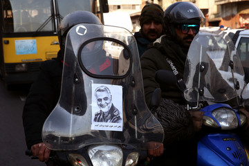 A picture of Iranian Major-General Qassem Soleimani, head of the elite Quds Force, who was killed in an air strike at Baghdad airport, is seen on a motorcycle in Tehran