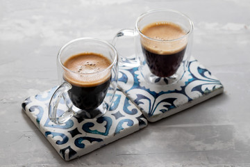 two cups of coffee on ceramic background