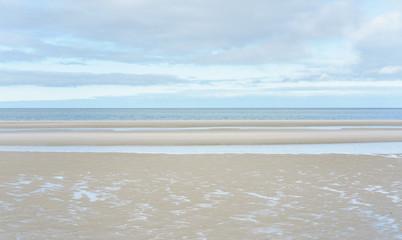 Fototapete - Strand am Meer bei Ebbe