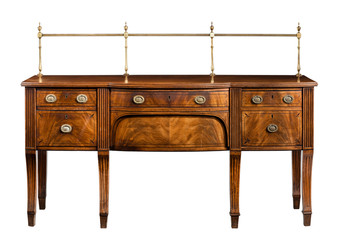 Antique bow fronted mahogany dining room sideboard serving table with brass rails handles isolated on white