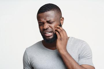 Spoed Foto op Canvas Hoogte schaal Sad man having gum problems, touching his cheek
