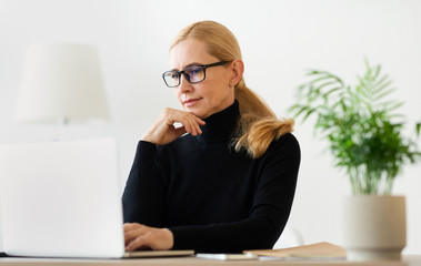 Woman psychologist consulting client online on computer