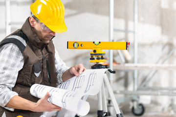 Architect structural engineer or builder with plan