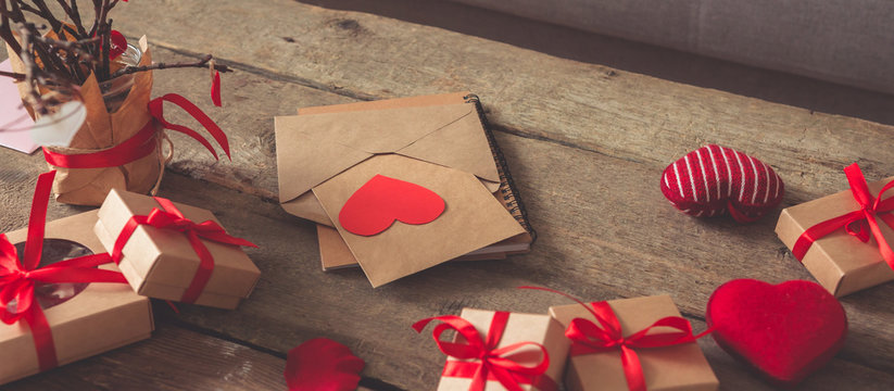 Valentine's day, wedding zero waste, eco-friendly gift wrapping kraft paper and branches with hearts, gift basket, cozy winter winter evening eco concept eco-friendly banner decor