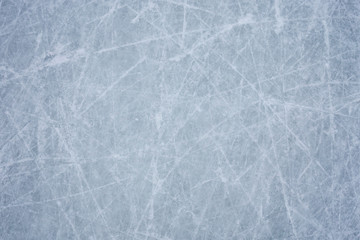 Ice background with marks from skating and hockey, blue texture of rink surface with many scratches