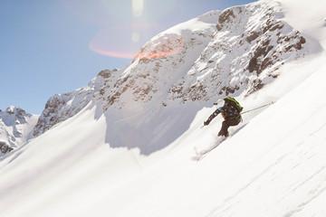 One woman skiing on a sunny spring day at Silverton Mountain, Silverton, Colorado.