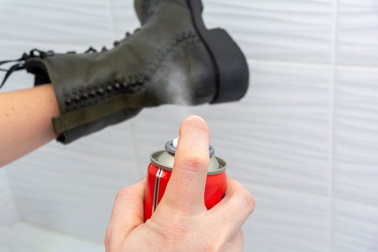 shoe and water-repellent spray for shoes in the hands of a Caucasian woman. Leather shoe care. shoe and water-repellent spray for shoes in the hands.