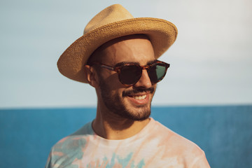 Picture of hipster man standing isolated over blue background