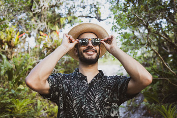 Young male traveler hipster exploring the nature