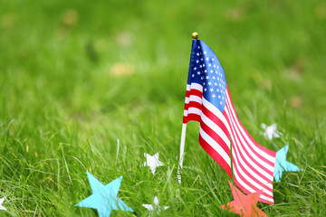USA flag and stars outdoors. Memorial Day celebration
