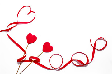 Greeting card for Valentine's Day with wooden red hearts,  and a heart of red strip on a white  background.  Flat lay.