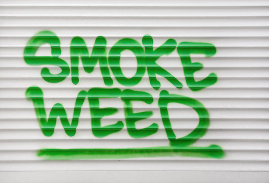 Smoke weed green text sign