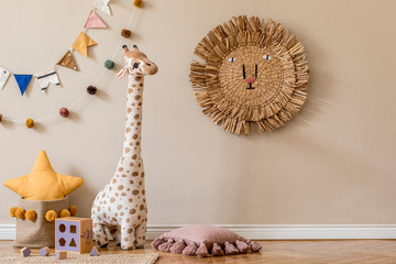 Stylish scandinavian interior of child room with natural toys, hanging decoration, pillows, plush...