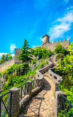 San Marino, medieval tower on a rocky cliff and pathway