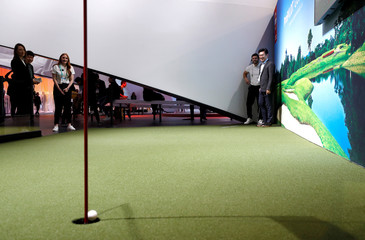 A ProPilot golf ball, using Nissan's ProPilot Assist technology, drives itself into the hole during the 2020 CES in Las Vegas