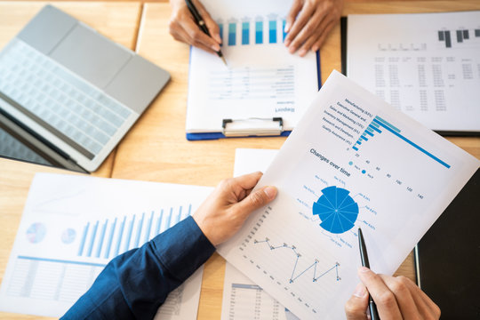 Business People Meeting to analyse and discuss and brainstorming the financial report chart data in office, Financial advisor teamwork and accounting concept.