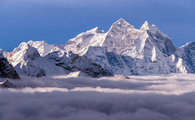 Majestic Himalayan peaks towering above the clouds at sunrise in Nepal, Himalayas mountains. Kangtega peak (6782 m) on the right side of the frame Wall mural