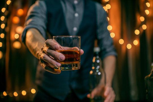 Barman pouring whiskey whiskey glass