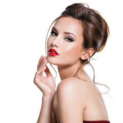 face of beautiful woman with bright red lipstick on the lips
