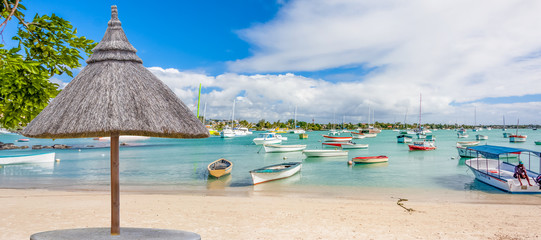 umbrella and chairs on tropical beach, Mauritius