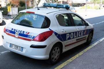 car of French national police in city street