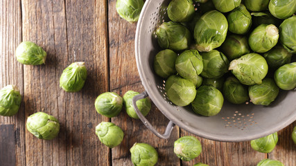 Acrylic Prints Brussels raw brussel sprouts on wood background