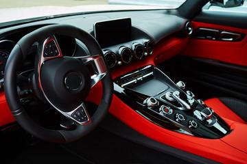 Luxury car Interior. Steering wheel and dashboard.