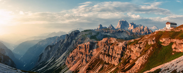 Awesome Nature Landscape. Amazing Dolomite Mountains Landscape during sunset. Incredible view of Dolomites Alps. Tre Cime di Lavaredo National park. Picture of wild area. Amazing alpine valley
