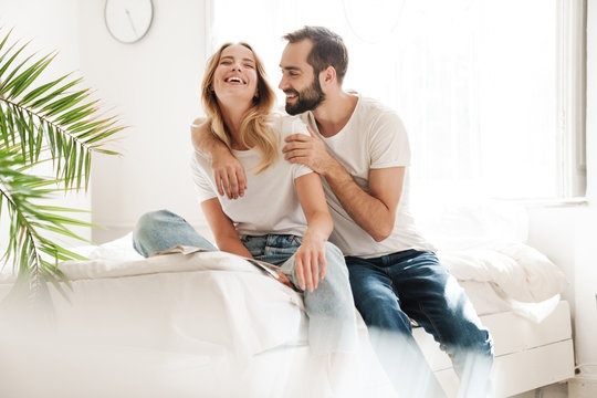 Happy young couple in love relaxing on a couch