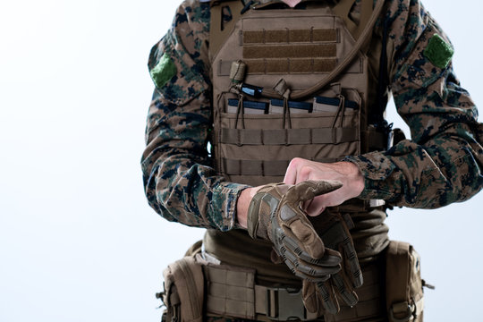 closeup of soldier hands putting protective battle gloves