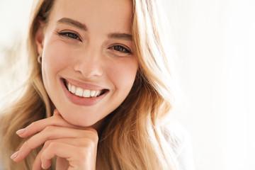 Smiling young beautiful blonde woman wearing t-shirt