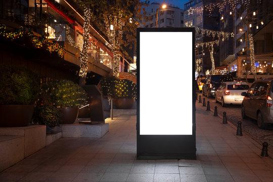 Blank billboard on night street