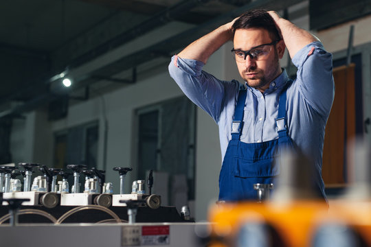 Industrial worker being worried for bad results in production.