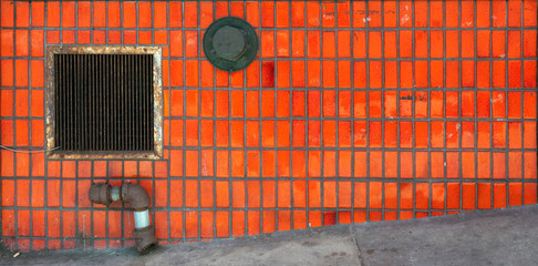 Dirty neglected vintage orange tile wall. Wall mural